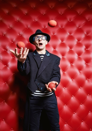 juggler: The clown the man, juggles with balls Stock Photo