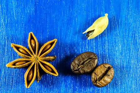 badiane: Star anise with coffee beans and kardamon on wooden background Stock Photo