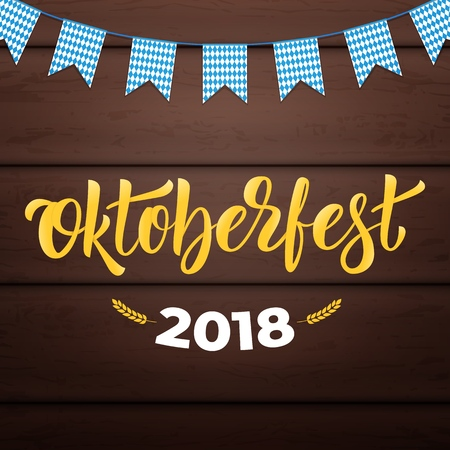 Oktoberfest 2018. Trendy Oktoberfest lettering on wooden background
