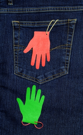 rapprochement: Two paper palms with threads at the back pocket of jeans, are drawn to each other