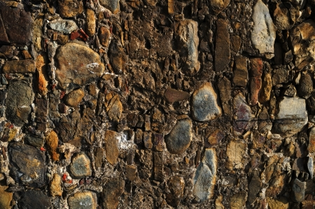 A wall of stones of different size and color Stock Photo - 20143054