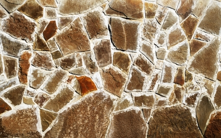 varying: The contrasting texture of the brown stone varying shapes and sizes, sealed with cement