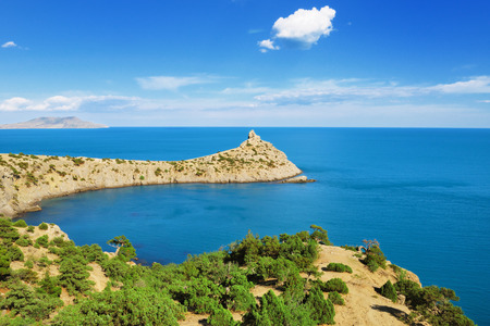 Blue Bay and Cape Kapchik with juniper grove on the Black sea coast, Crimea photo