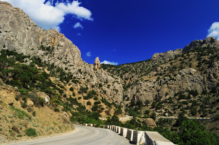 rocky mountain juniper: Beautiful summer mountain landscape - winding road in the gorge, Crimea Stock Photo