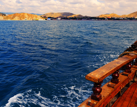 pleasure craft: View of the coast of the Black Sea from the deck of a wooden pleasure craft
