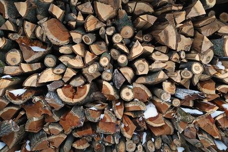 neatly stacked: Background - a large pile of harvested for winter firewood neatly stacked Stock Photo
