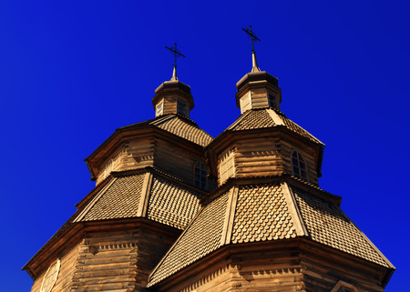 cossack: Wooden cossack church Covers of the Blessed Virgin on the island Hortitsa in Zaporozhye, Ukraine Stock Photo