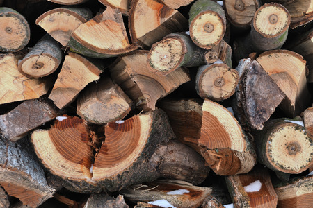 neatly stacked: Pile of harvested firewood for winter neatly stacked closeup Stock Photo