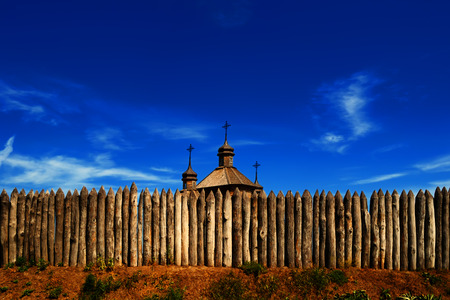 palisade: View on the top of a wooden cossack church Covers of the Blessed Virgin located behind the palisade of logs, on the island of Hortitsa, Ukraine
