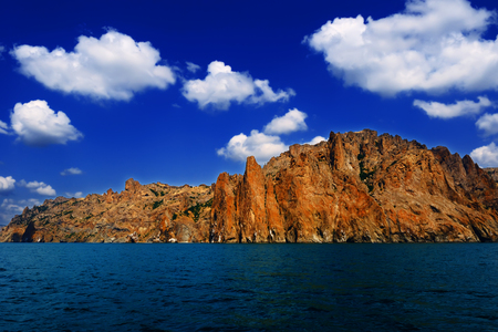Scenic landscape - view from the sea on famous natural reserve of Karadag volcanic massif and rock Golden gate in the Crimea
