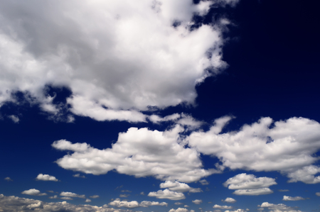 Beautiful breathtaking scenery - cloudy sky on a bright sunny day in summer Фото со стока