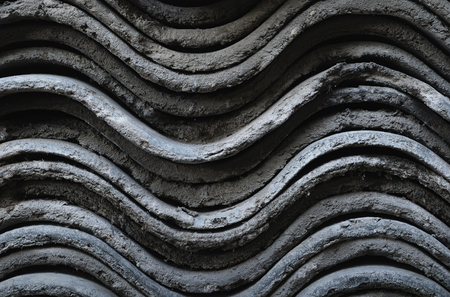 A side view on the slate sheets stacked on each other closeup Фото со стока