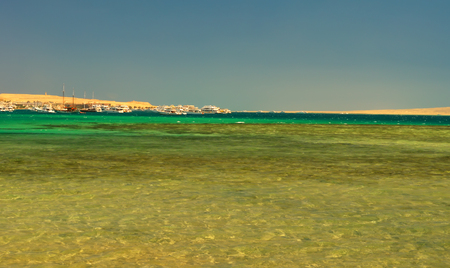 Beautiful seascape - the Red sea with yachts parked, and coral reef off the coast of Hurghada, Egypt
