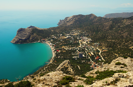 A top view of the settlement of Novy Svet, the surrounding mountains and Green Bay in the Crimea
