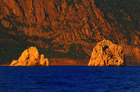 Scenic landscape - rocks Adalary illuminated the sun at sunset, summer, Gurzuf, Crimea