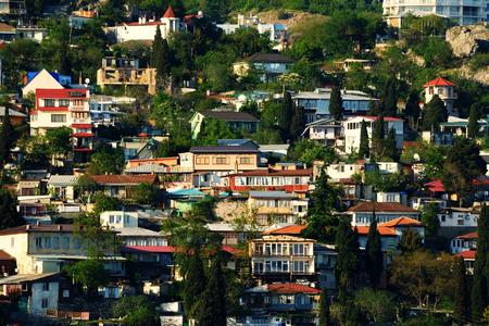 View of the picturesque resort village of Gurzuf, Crimea, summer evening Фото со стока