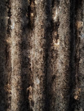 The wavy texture of aging slate closeup Фото со стока