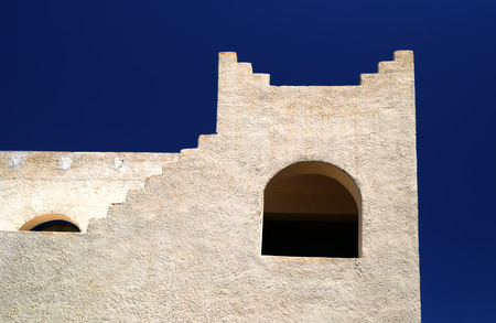 Architectural rough structure of white color in Oriental style on the background of dark blue sky
