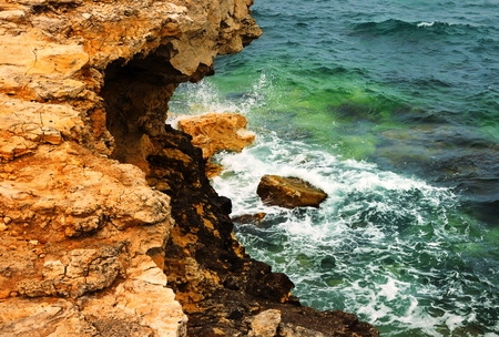 Waves of the Black Sea breaking on a rocky shore, the coast of the Chersonese, Sevastopol, Crimea