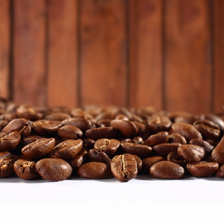 coffee beans on white table photo