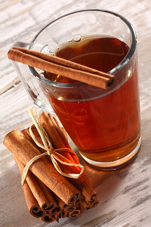 warming tea and cinnamon sticks Stock Photo - 13185009