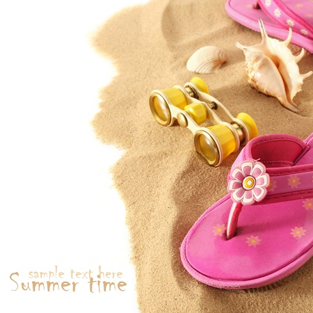 pink flip-flops on sand with white space for your text photo