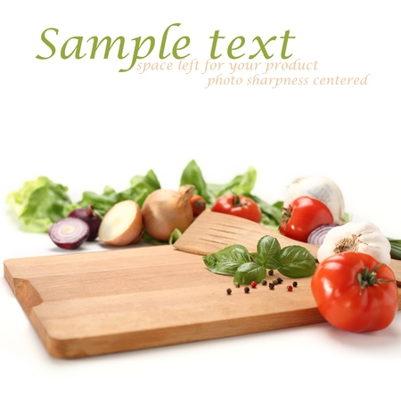 chopping board with fresh vegetable on the side photo
