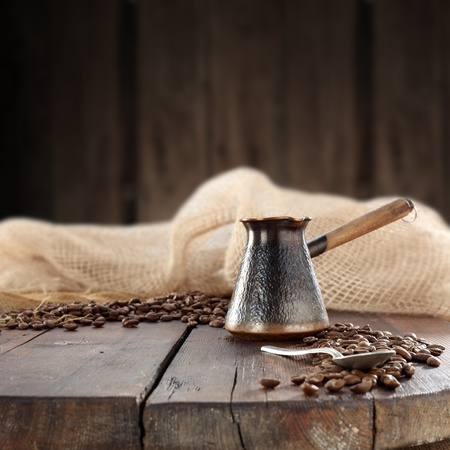 turkish coffee pot on wooden table photo