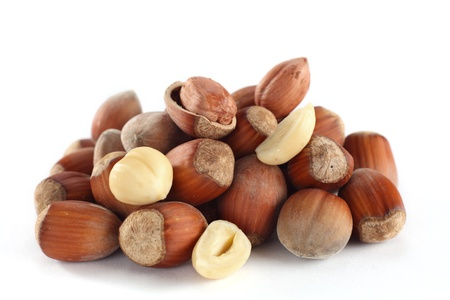 bunch of cracked and whole hazelnuts