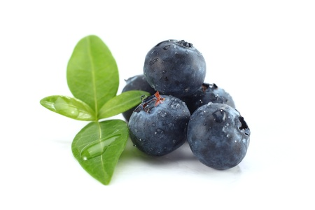 fresh blueberries with green leaf on white Stock Photo