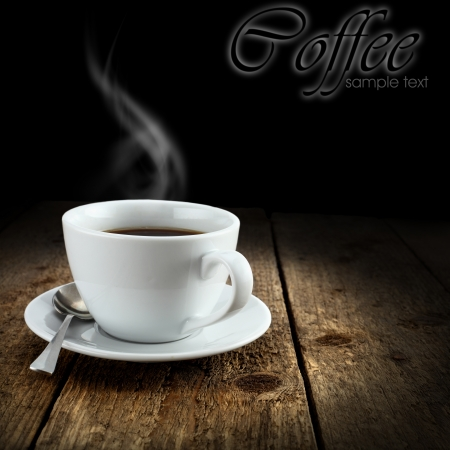 hot coffee on rustic table and black background Stock Photo