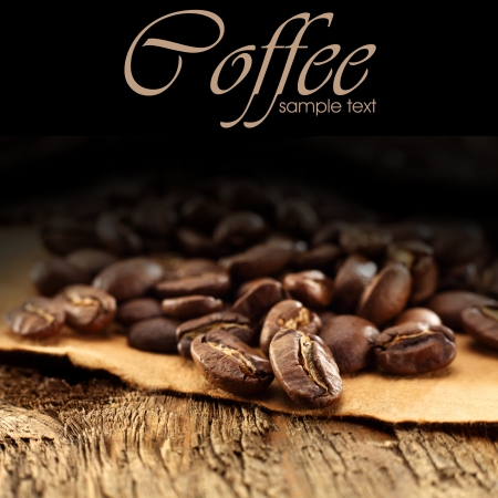 coffee beans on brown paper and black background photo