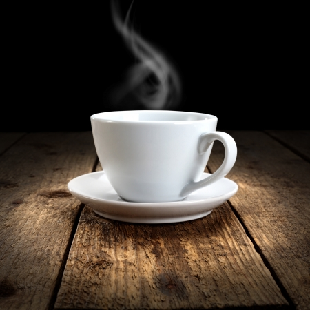 hot drink on wooden table and black background photo