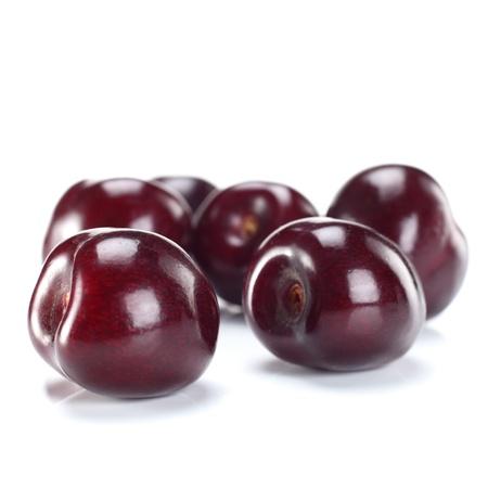ripe sweet cherries on white