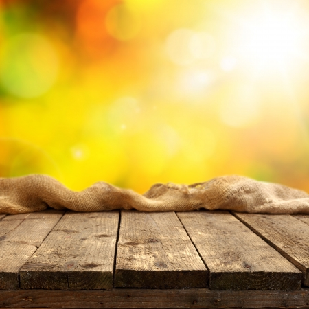 golden autumn background with rustic plank table Stock Photo