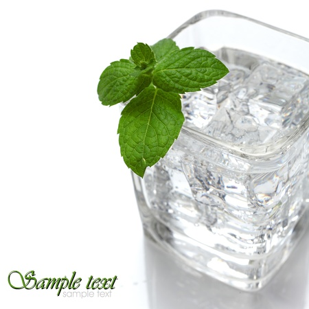 water with ice and mint on white background photo