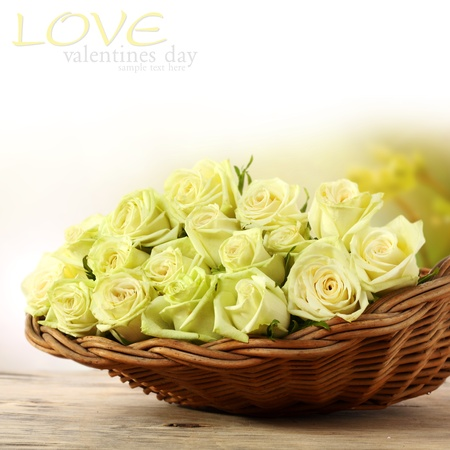 bunch of yellow roses in wicker basket Stock Photo - 15734280