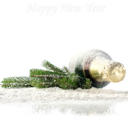 champagne with pine branch on snowflakes photo