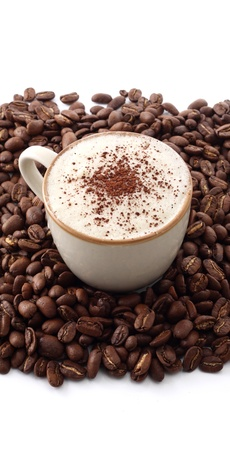 cup of cappucino on roasted coffee beans photo