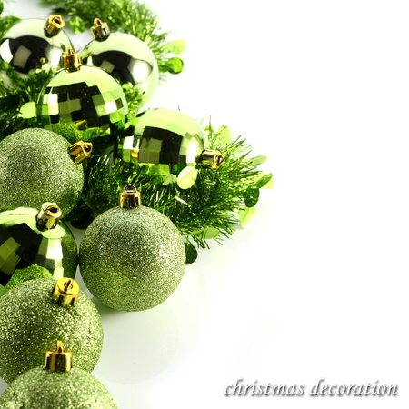 white background with green baubles photo