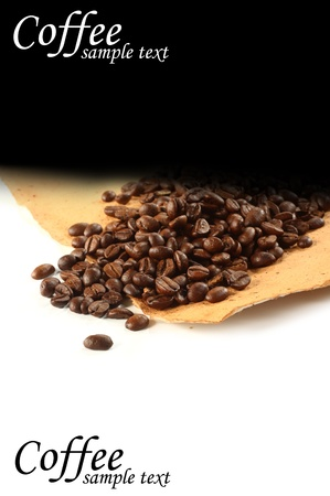 coffee beans on parchment with black background photo