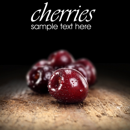 several cherries on black background Stock Photo - 15715044