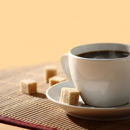 hot coffee with sugar cubes photo