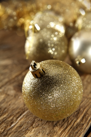 gold baubles on rustic table photo