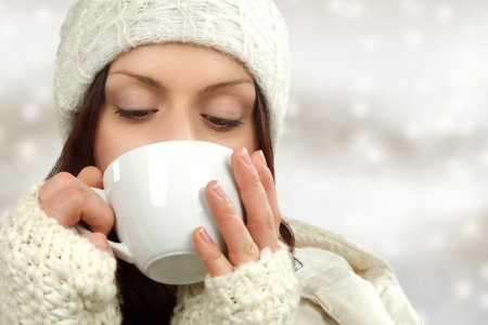 woman with warming drink photo