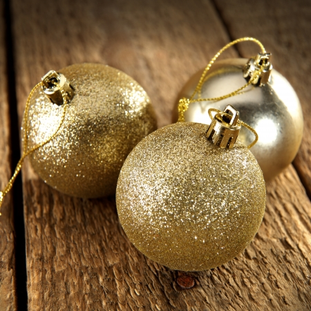 three gold baubles photo