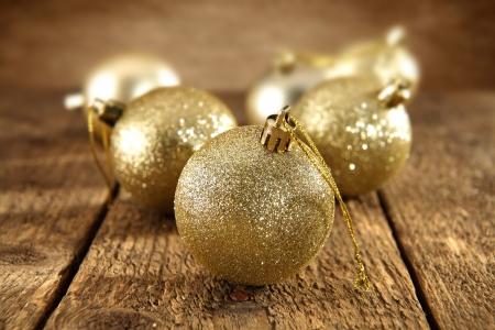 gold baubles on rustic background photo