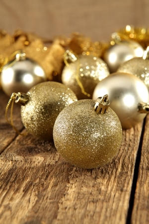 golden baubles on rustic plank table photo