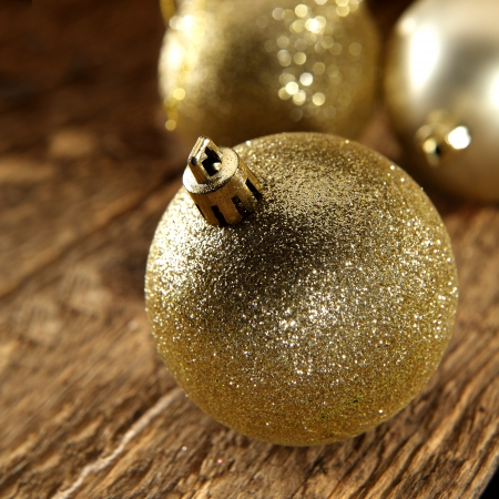 gold bauble on rustic plank photo