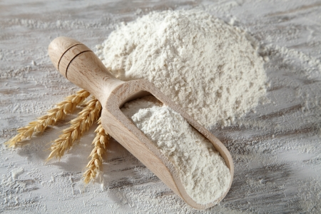 white flour with wooden scoop